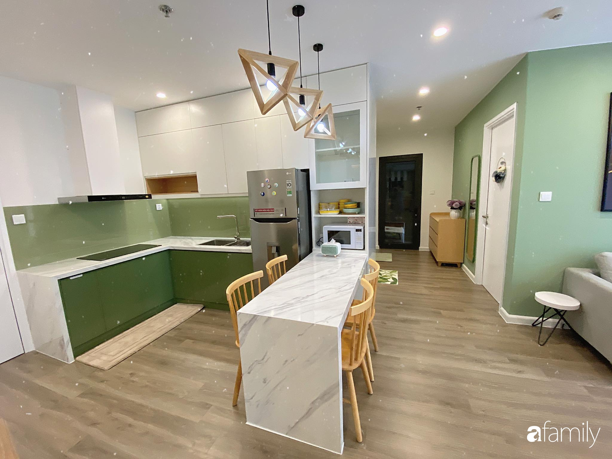 Căn hộ 59m² màu xanh lá xua tan nóng bức mùa hè có chi phí hoàn thiện 225 triệu đồng ở Hà Nội - Ảnh 11.