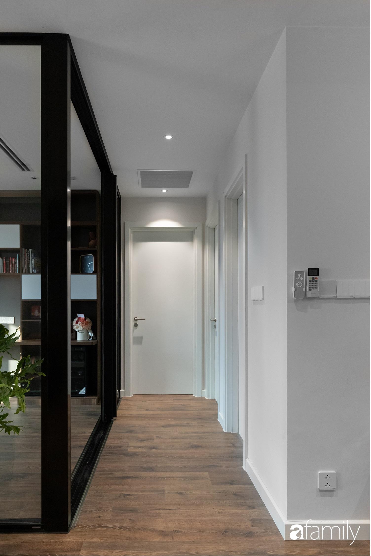 Căn hộ với chi phí phần nội thất gỗ có giá 200 triệu đồng đẹp cuốn hút theo phong cách tối giản ở Hà Nội - Ảnh 12.
