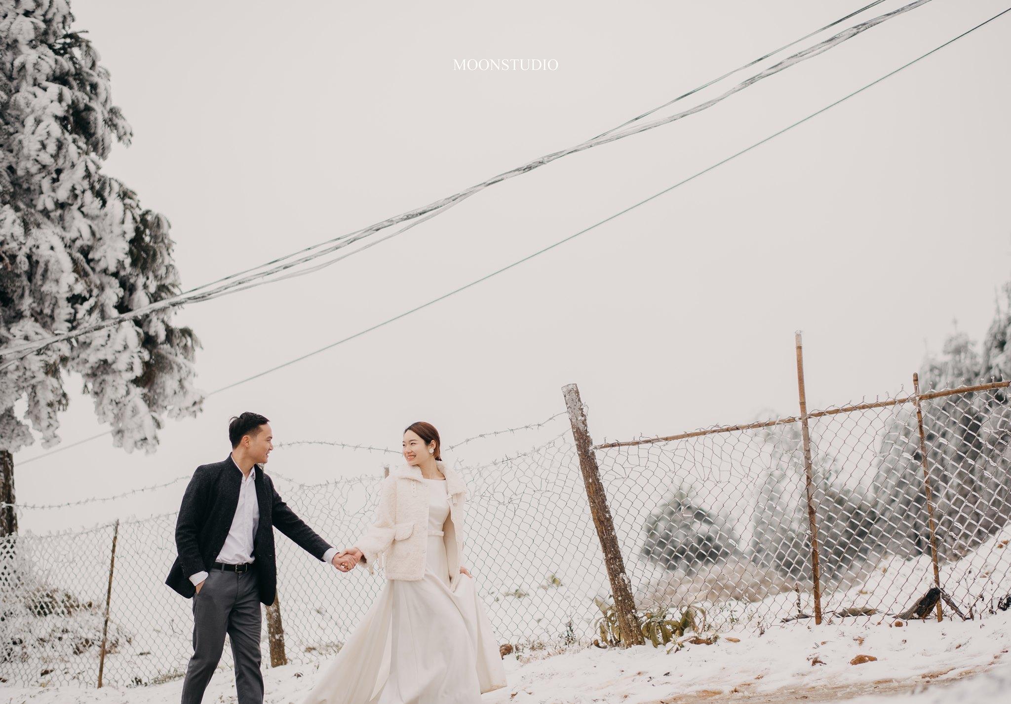 Mê mẩn với bộ ảnh cưới trong tuyết của cặp đôi may mắn, dù váy cưới cô dâu bị đóng băng do quá lạnh - Ảnh 9.