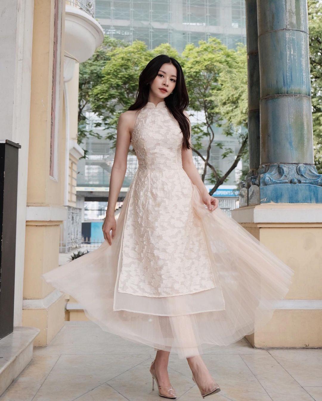 Sao Việt rộn ràng diện áo dài đón Tết sớm, kiểu hot hit nhất năm nay nằm cả ở chi tiết này - Ảnh 14.