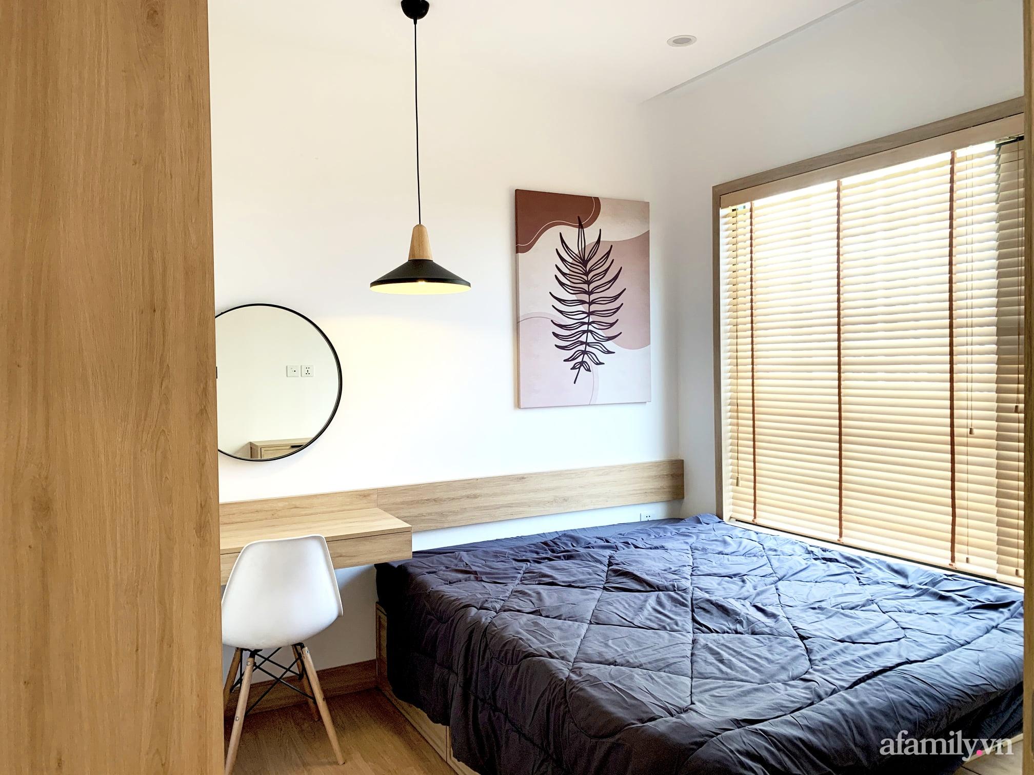 Căn hộ 72m² cực ít đồ đạc vẫn đẹp tinh tế và tiện dụng nhờ thiết kế nội thất thông minh ở Sài Gòn - Ảnh 10.