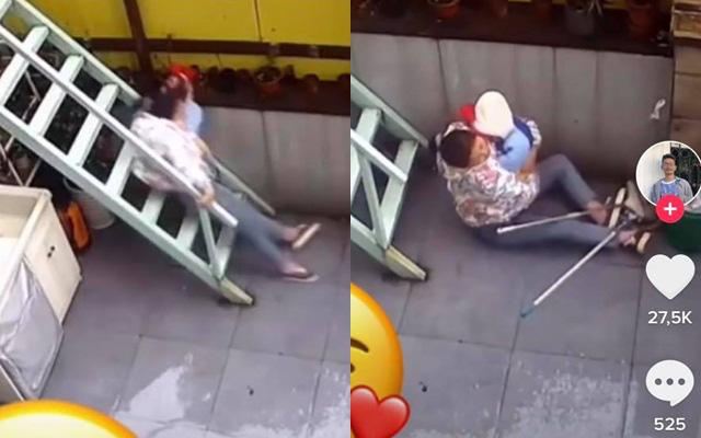 Đang bế con nhỏ thì trượt ngã cầu thang, người mẹ hành động ngay tức khắc theo bản năng khiến ai nhìn cũng thấy cảm động