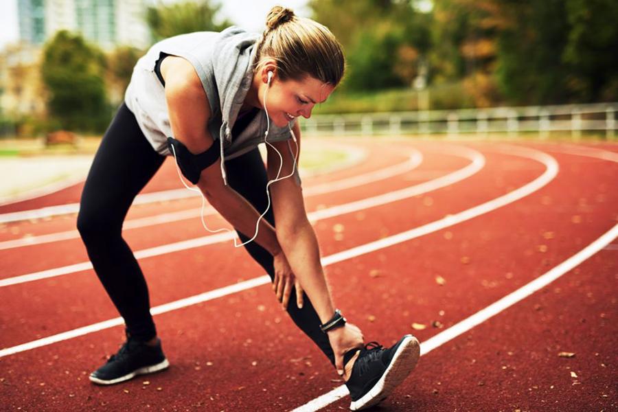 smiling-blonde-sportswoman-stretching.jpg
