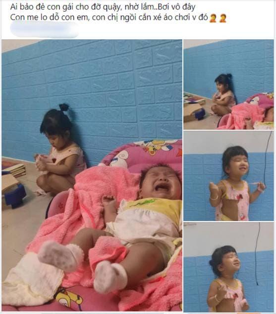 """Lo dỗ bé út ngủ, tự nhiên thấy bé lớn im lặng hồi lâu, người mẹ ngẩng lên thì thấy ngay """"pha xé áo đi vào lòng bàn tay"""" của con gái  - Ảnh 1."""