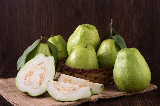 close-up-delicious-beautiful-guava-set-with-fresh-green-leaves_315337-1954.jpg