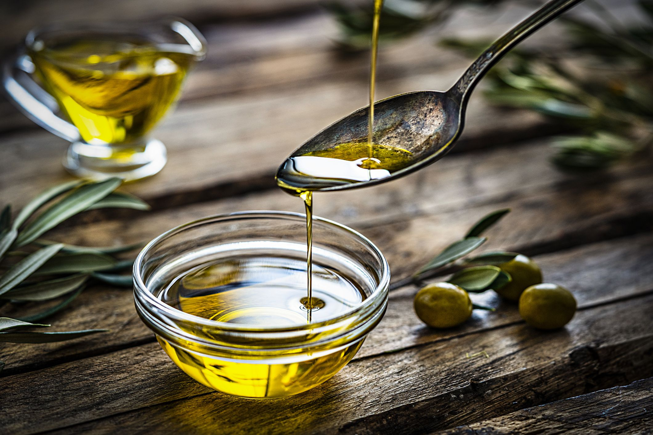 pouring-extra-virgin-olive-oil-royalty-free-image-1597238508.jpg