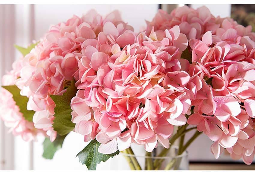 Không khéo tay cắm tay hoa tươi thì chọn ngay những loại hoa giả trang trí nhà cửa này, khách đến chơi ai cũng khen tấm tắc - Ảnh 1.