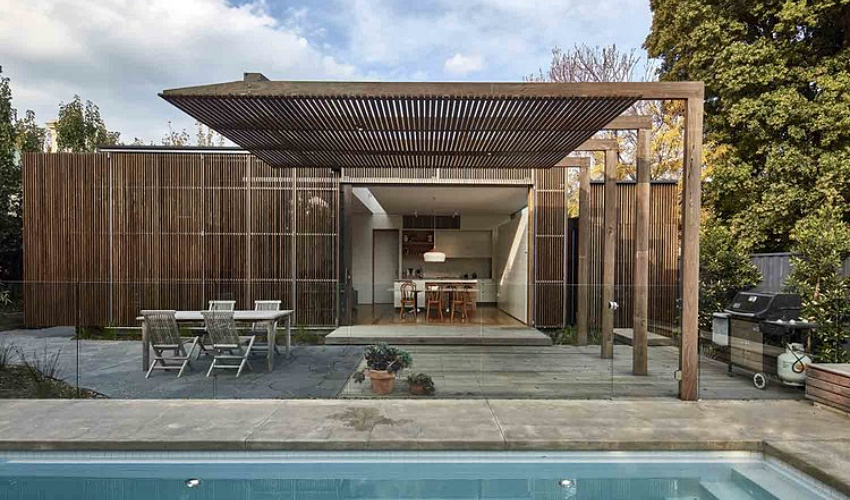 Căn nhà gỗ một tầng mang cuộc sống của gia đình trẻ hòa mình cùng thiên nhiên - Ảnh 3.