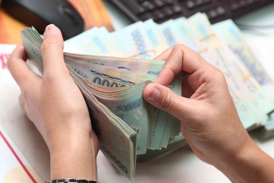 Từ hôm nay 1/8, NAPAS giảm 50-75% phí giao dịch ngân hàng - Ảnh 1.