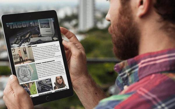 Chuyển từ báo giấy sang báo mạng, một tờ báo bỏ ra hàng triệu USD mua iPad tặng độc giả - Ảnh 1.