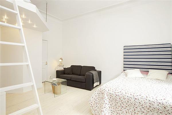 Chỉ vỏn vẹn 38m² nhưng căn hộ nhỏ ấm cúng này có không gian chứa được vô số đồ đạc   - Ảnh 1.
