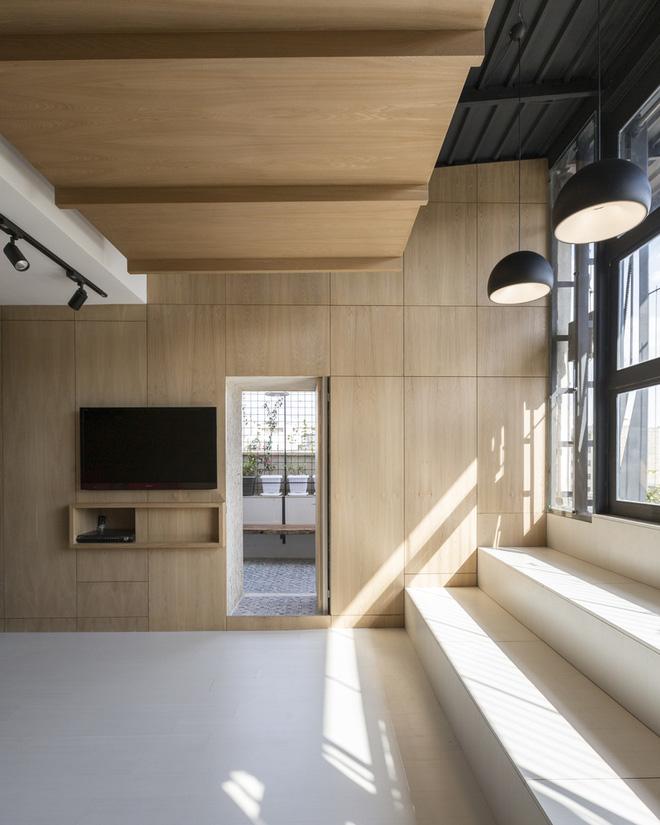 Căn hộ 45m² cực ấn tượng với giường treo và hệ tủ âm tường biến hóa khôn lường - Ảnh 12.