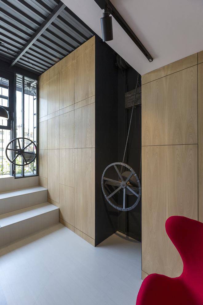 Căn hộ 45m² cực ấn tượng với giường treo và hệ tủ âm tường biến hóa khôn lường - Ảnh 9.