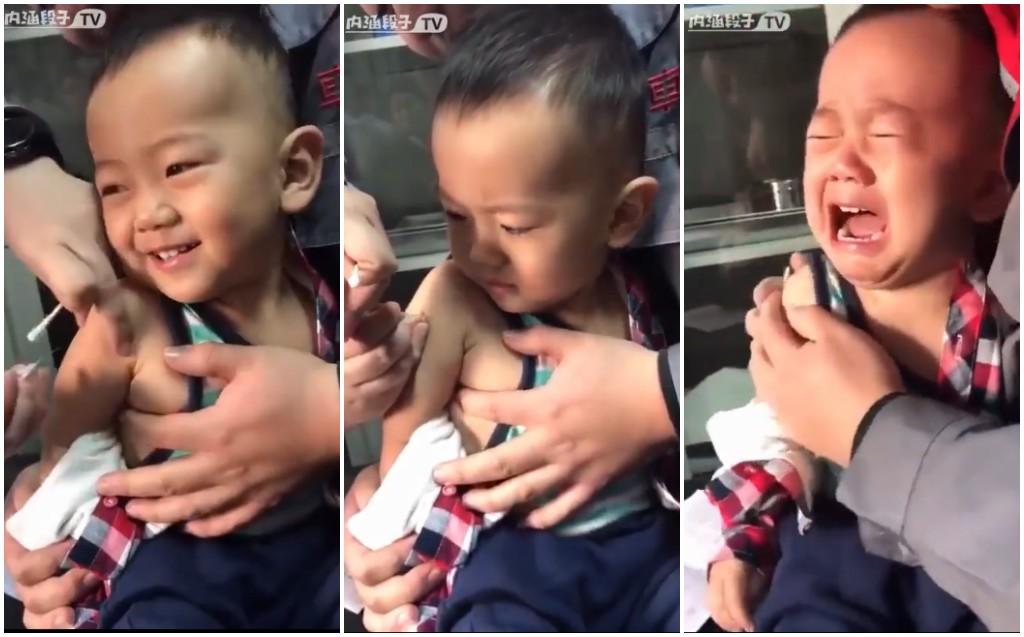 Biểu cảm vô cùng đáng yêu của cậu bé khi đi tiêm, dở khóc dở cười là đây chứ đâu - Ảnh 2.