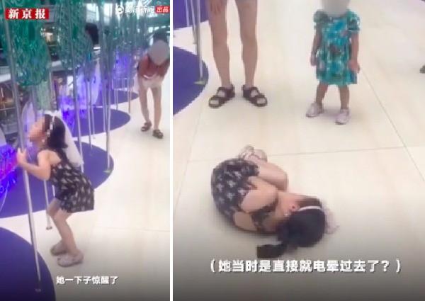 Cảnh tượng bé gái bị điện giật run bần bật tại trung tâm thương mại trước mặt mẹ khiến phụ huynh nào xem xong cũng rùng mình - Ảnh 2.