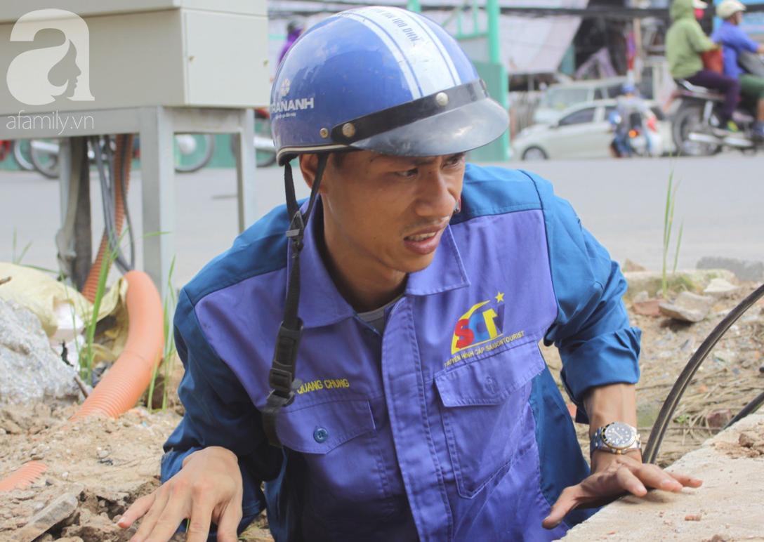 Hà Nội: Người lao động oằn mình mưu sinh dưới cái nắng gần 40 độ C giữa trưa hè - Ảnh 1.
