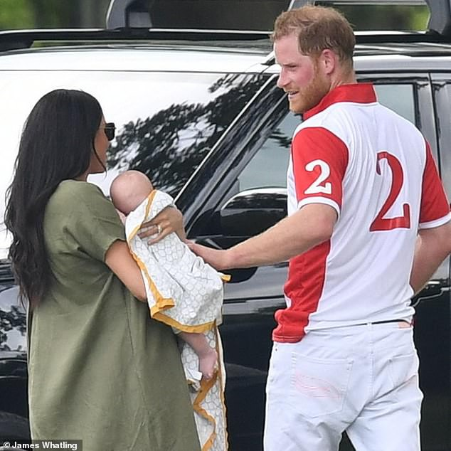 15876212-7234597-Proud_dad_Sweaty_Prince_Harry_gave_his_son_an_affectionate_pat_a-a-157_1562800767356