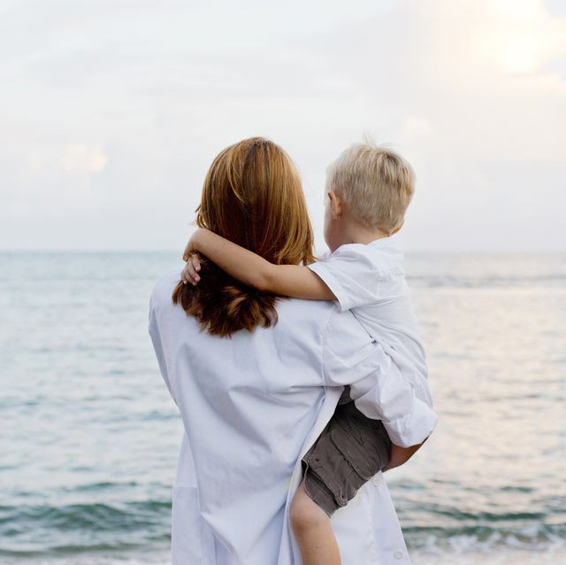 mother-and-son-admiring-ocean-royalty-free-image-592014719-1556290551
