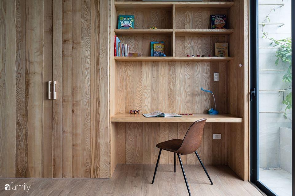 Ngôi nhà phố đẹp tinh tế với bản hòa tấu giữa vật liệu gỗ và ánh sáng ở Quy Nhơn dành cho gia đình 4 người - Ảnh 19.