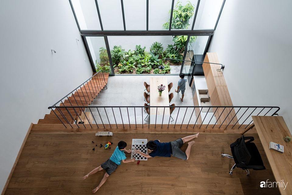 Ngôi nhà phố đẹp tinh tế với bản hòa tấu giữa vật liệu gỗ và ánh sáng ở Quy Nhơn dành cho gia đình 4 người - Ảnh 18.