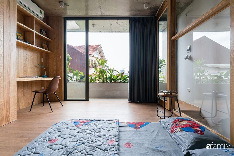 Ngôi nhà phố đẹp tinh tế với bản hòa tấu giữa vật liệu gỗ và ánh sáng ở Quy Nhơn dành cho gia đình 4 người - Ảnh 20.