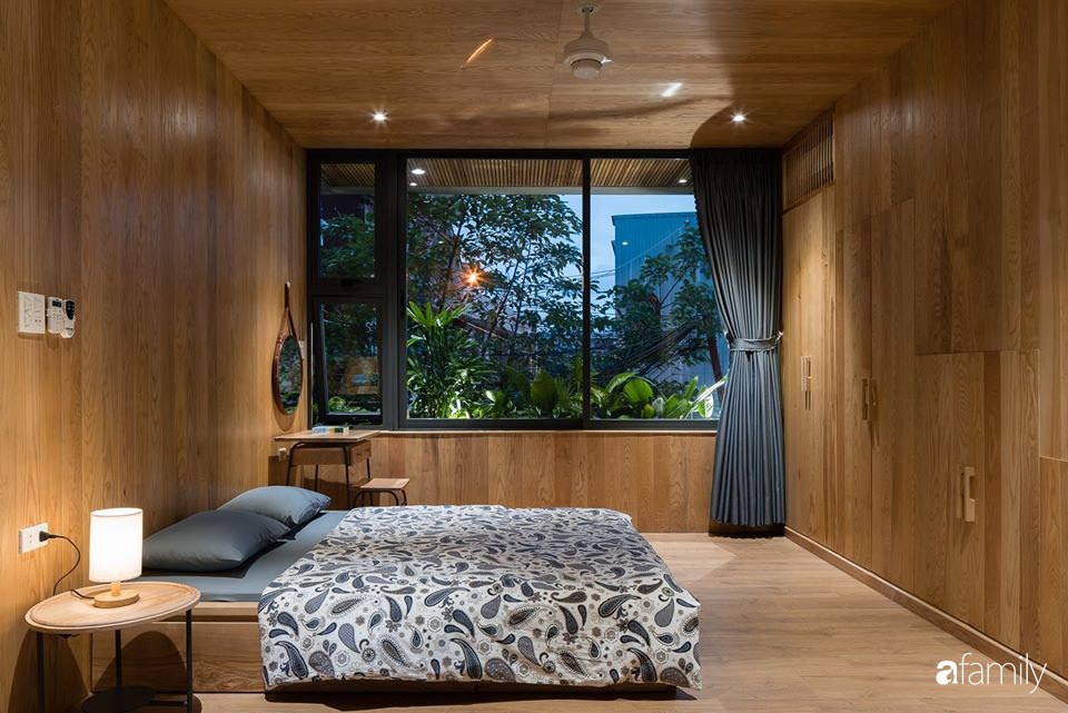 Ngôi nhà phố đẹp tinh tế với bản hòa tấu giữa vật liệu gỗ và ánh sáng ở Quy Nhơn dành cho gia đình 4 người - Ảnh 13.