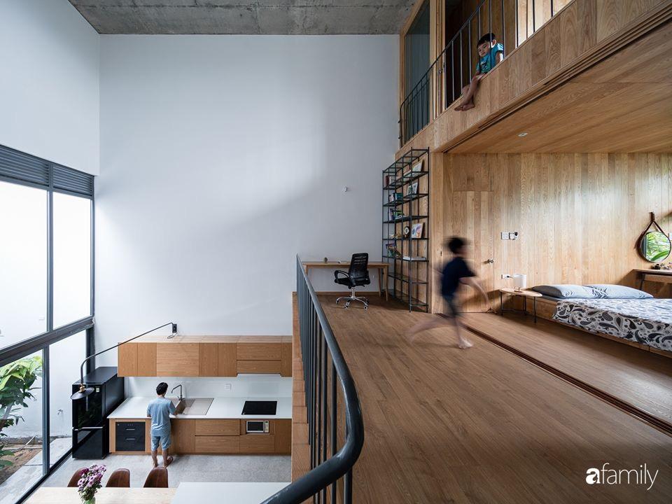 Ngôi nhà phố đẹp tinh tế với bản hòa tấu giữa vật liệu gỗ và ánh sáng ở Quy Nhơn dành cho gia đình 4 người - Ảnh 17.