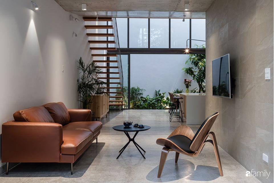 Ngôi nhà phố đẹp tinh tế với bản hòa tấu giữa vật liệu gỗ và ánh sáng ở Quy Nhơn dành cho gia đình 4 người - Ảnh 5.