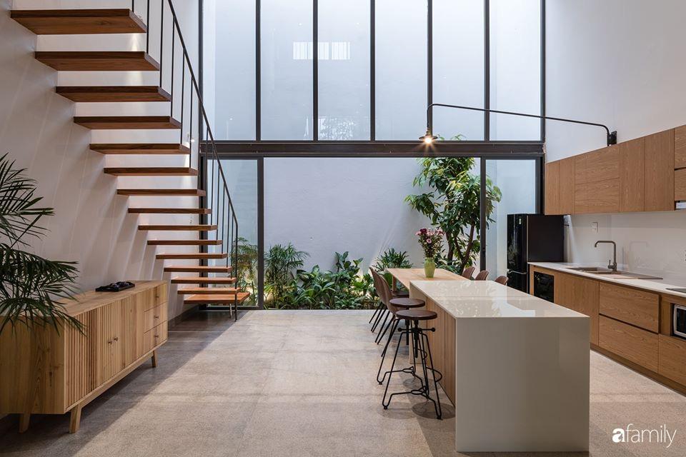 Ngôi nhà phố đẹp tinh tế với bản hòa tấu giữa vật liệu gỗ và ánh sáng ở Quy Nhơn dành cho gia đình 4 người - Ảnh 9.