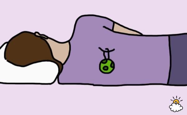 nằm nghiêng bên trái khi ngủ