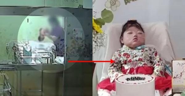 Em bé nhắm nghiền mắt trong sinh nhật đầu tiên tưởng...