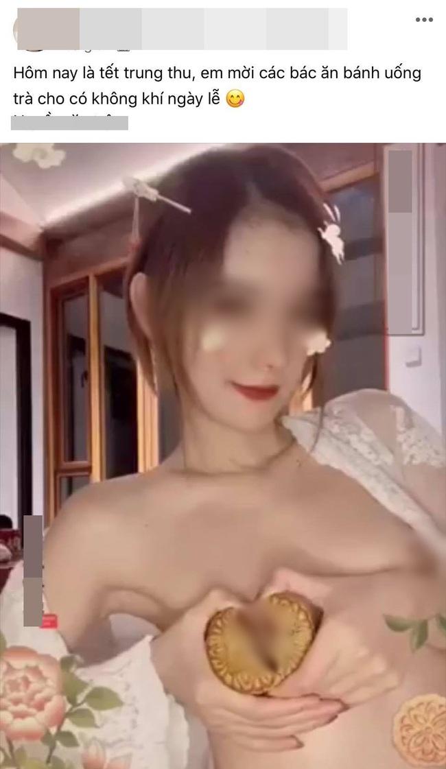 Bức ảnh cô gái cho bánh Trung thu vào chỗ nhạy cảm - Ảnh 1.