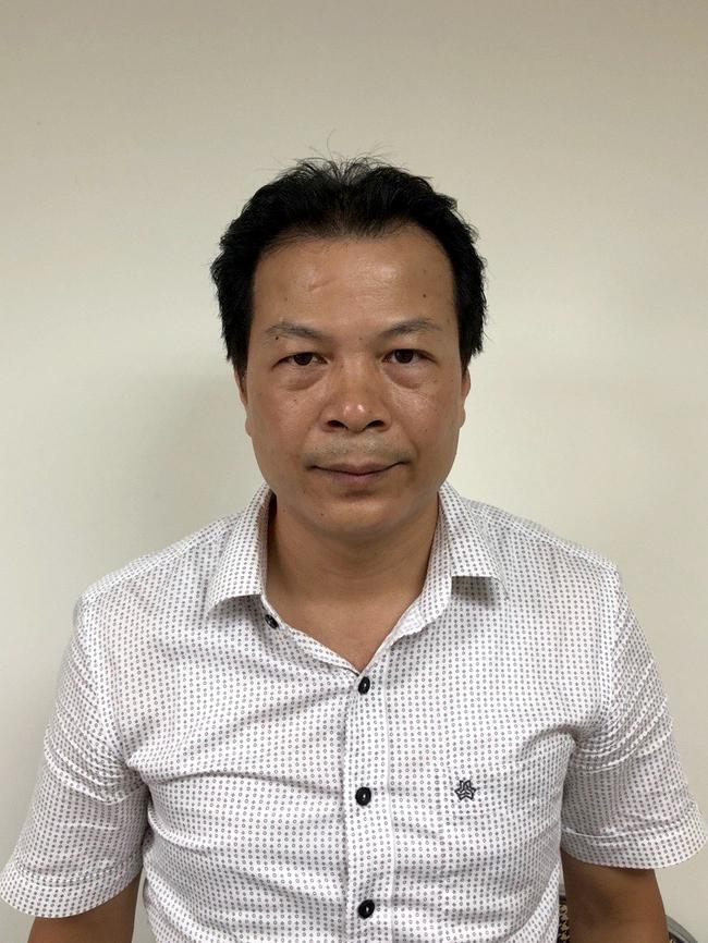 Vụ mua máy xét nghiệm COVID-19 tại Hà Nội: Khởi tố thêm 2 trưởng phòng - Ảnh 1.