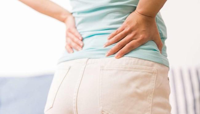 Đau lưng dưới: Khi nào nên đi khám và điều trị - Ảnh 1.