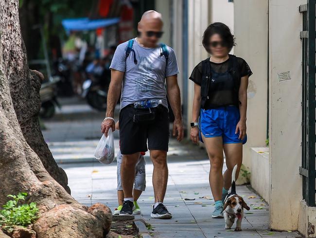 Hà Nội: Người dân thờ ơ trước việc tái xử phạt không đeo khẩu trang - Ảnh 11.