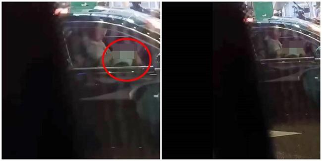 Đoạn clip quay cô gái trẻ cúi xuống tưởng buộc dây giày cho người đàn ông cầm lái, nhưng khi nhìn kỹ lại cảnh tượng bên trong khiến ai cũng đỏ mặt - Ảnh 1.