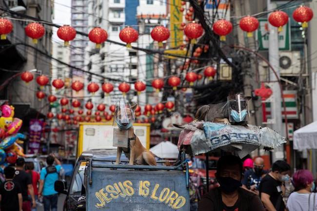 Các nước châu Á đón Tết Nguyên đán: Không khí trầm lắng nhưng vẫn không thể thiếu bữa ăn sum họp, đi lễ cầu may - Ảnh 14.