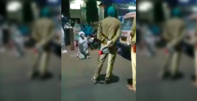 Video người đàn ông mặc đồ bảo hộ kín mít quỳ lạy cảnh sát lan truyền chóng mặt trên MXH, sự thật phía sau khiến dân mạng ứa nước mắt - Ảnh 2.