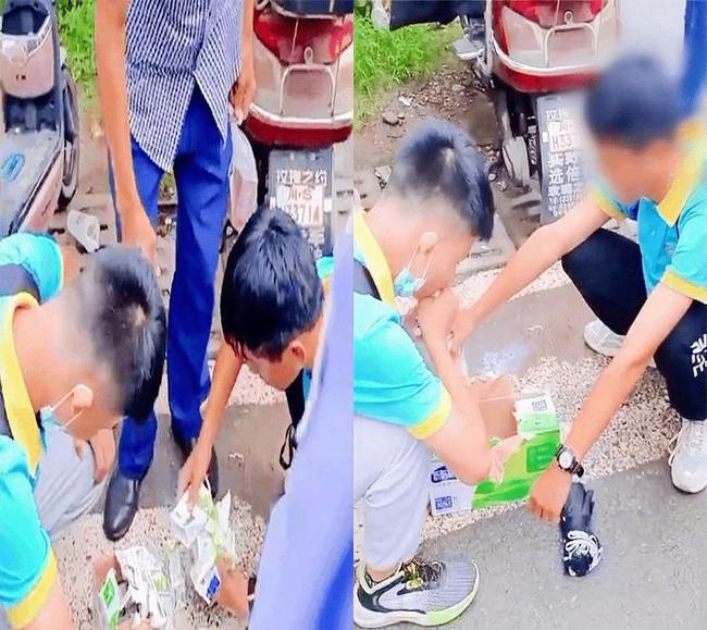 Hai học sinh phải uống cả thùng sữa ngay trước cổng trường vì nội quy vô lý, dân mạng lên án kịch liệt, cơ quan chức năng vào cuộc xử lý - Ảnh 2.