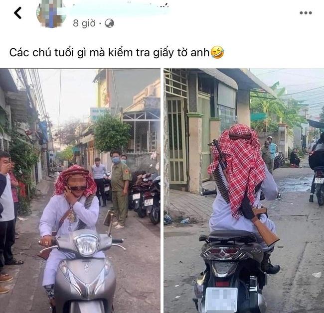 Thực hư bức ảnh người đàn ông cải trang đạo Hồi, đeo súng chạy xe giữa đường trong khi dân quân trực chốt ngơ ngác nhìn theo - Ảnh 1.