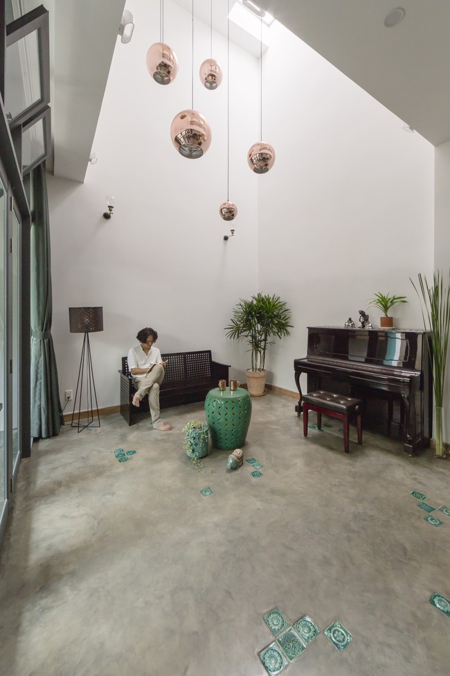 Ngôi nhà vừa để ở vừa cho thuê đẹp khó tin của gia đình trẻ ở Việt Nam khiến báo Mỹ thán phục - Ảnh 4.