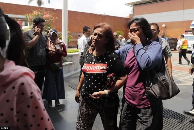 Hiện trường thảm khốc vụ máy bay chở 189 hành khách rơi xuống biển ở Indonesia, thi thể hành khách đầu tiên được tìm thấy - Ảnh 20.