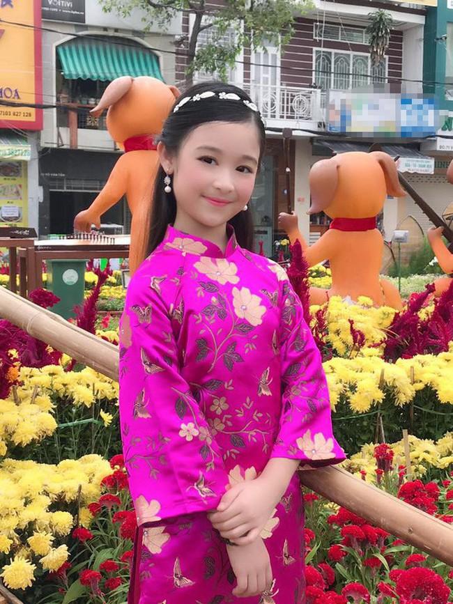 Nhan sắc lịm tim của bé gái ngồi cạnh Hoa hậu Đỗ Mỹ Linh, danh tính cô bé mới khiến dân mạng bất ngờ - Ảnh 15.