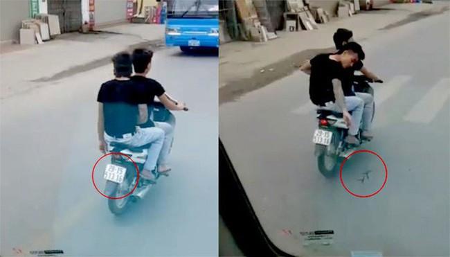 Truy tìm hai nam thanh niên đầu trần, lái xe máy rải đinh giữa đường phố Hà Nội - Ảnh 1.