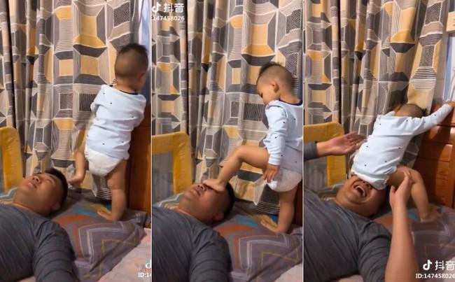 Gọi bố dậy mãi chẳng được, cậu bé đã áp dụng tuyệt chiêu của riêng mình khiến bố hét ầm rồi tỉnh giấc - Ảnh 2.