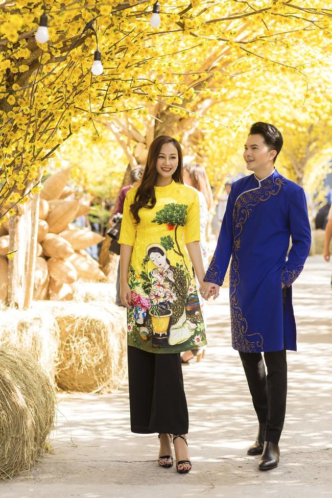 Nam Cường - Hà Thúy Anh diện áo dài đón Tết sớm ở phố ông đồ - Ảnh 6.
