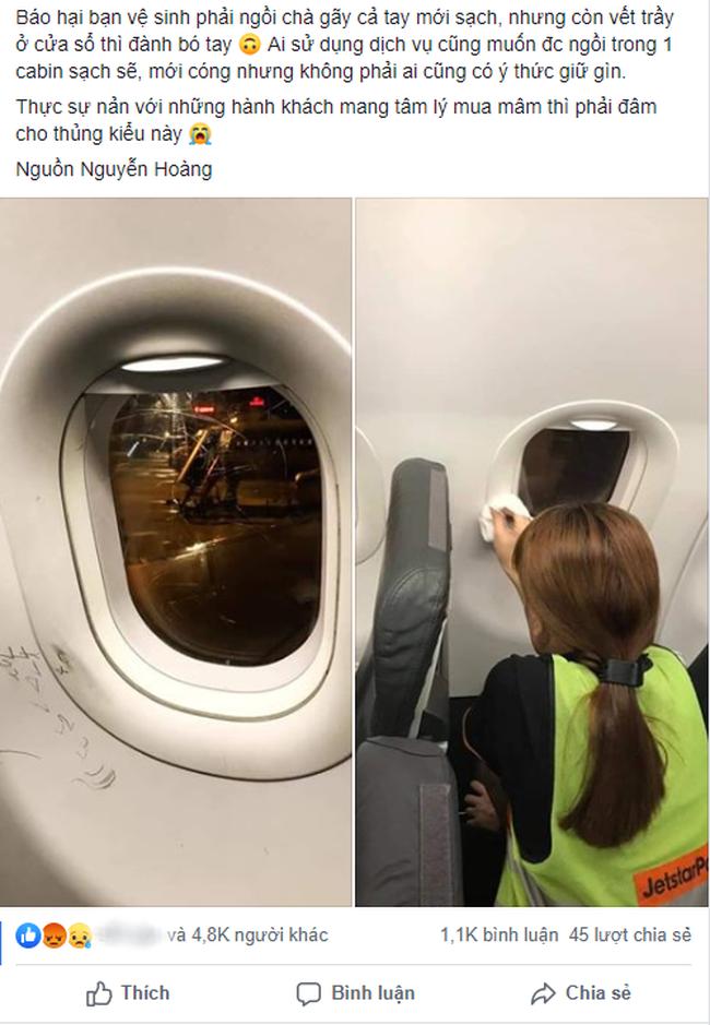 Hình ảnh nét vẽ nguệch ngoạc, cào xước cửa kính máy bay khiến dân mạng rần rần chỉ trích về ý thức hành khách - Ảnh 1.