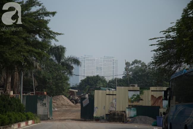 Hà Nội những ngày khói bụi bao trùm thành phố ngỡ như sương mù rải rác - Ảnh 5.