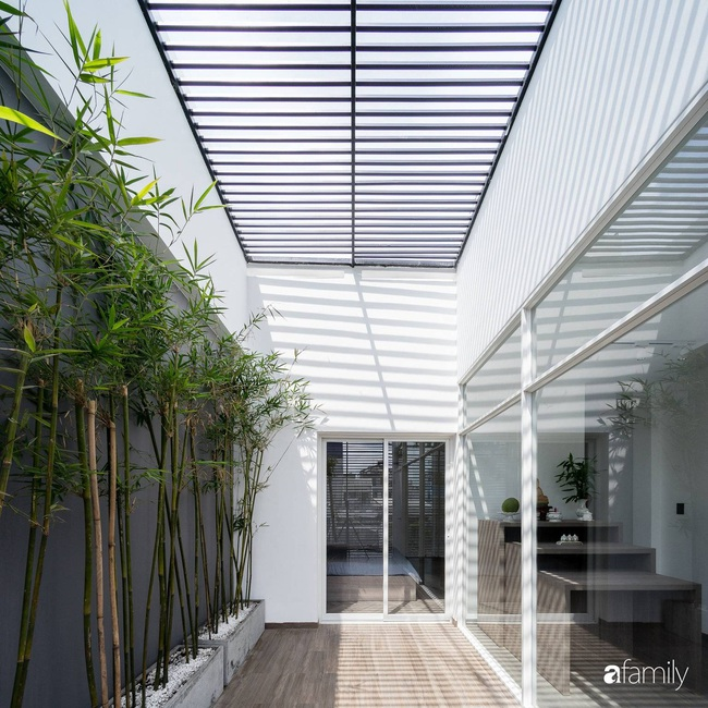 Ngôi nhà tối giản rộng 72m2 giúp con người được giao hòa với thiên nhiên ở quận 8, TP HCM - Ảnh 5.