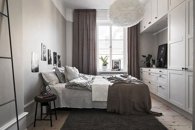 Căn hộ màu trắng rộng 62m2 chẳng hề nhàm chán nhờ cách trang trí có tính thẩm mỹ cao - Ảnh 12.